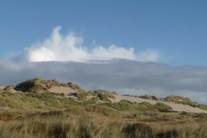 Landschap met duinen en wolken op Terschelling